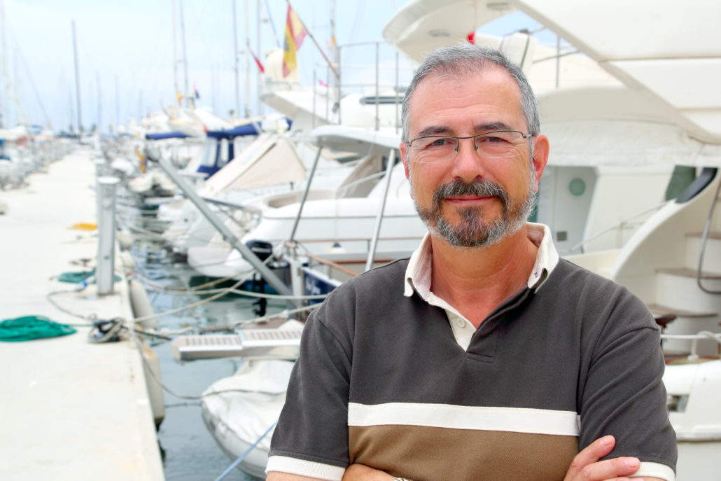 Foto Segellehrer vor Segelschiffen